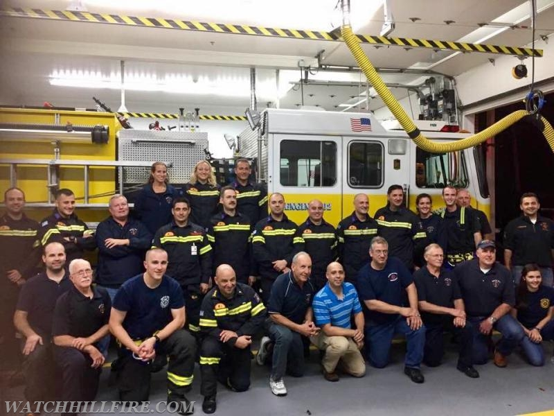 WHFD members gather next to Engine 102 with out Greek Brother & Sister Firefighters