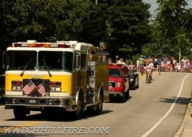 Engine 102 leads the patriotic trek down Bay Street on July 4th.