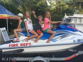 Kids enjoy exploring on ATVs, fire trucks, new and old, and had time to pose on Misquamicut Fire Department's jet ski.
