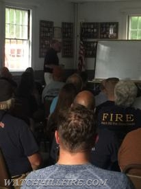 Chief Jared Meeker of Lake Shore Fire Department presents to firefighters and families.