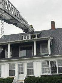 Firefighters check for fire extension at a structure fire caused by a lightning strike at 3 Lighthouse Road. The lightning struck the chimney and travelled into the attic. The damage was confined to the chimney, the wiring and a light fixture in the attic.