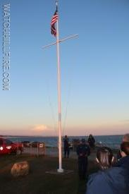 The ceremony begins by the Flag at the Watch Hill Lighthouse