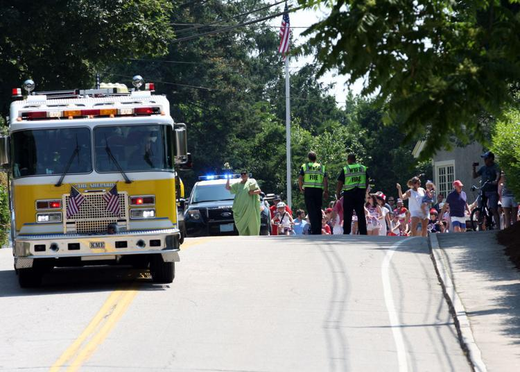 Engine 102 leads the annual 4th of July Bike Parade down Bay Street.