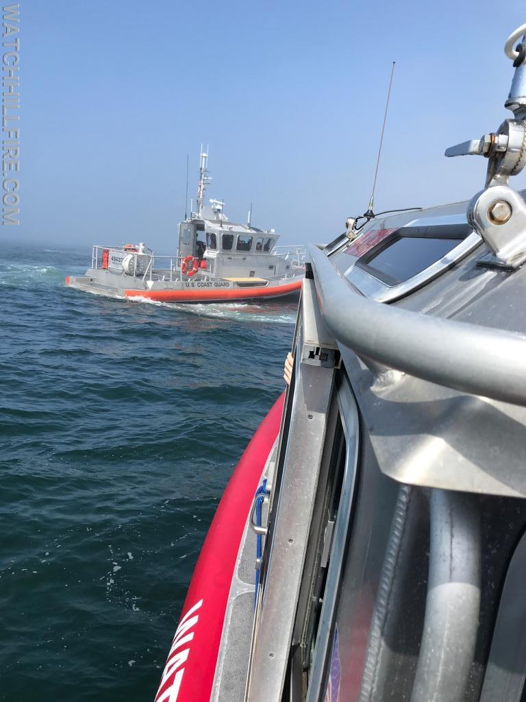 Watch Hill Marine 101 pulls up along the US Coast Guard 45' response boat during the response to a sinking vessel on Saturday Morning.