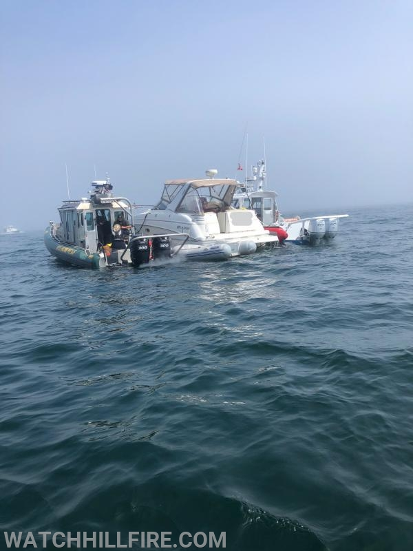 Tow Boat US and the New York State Department of Environmental Conservation Police Boat assist the vessel in distress.