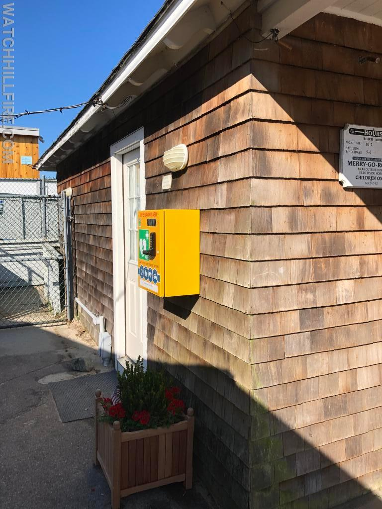 The new AED and Access Security Box at the Watch Hill Fire District Merry Go Round Ticket Office by the Bay Street Public Bathrooms.