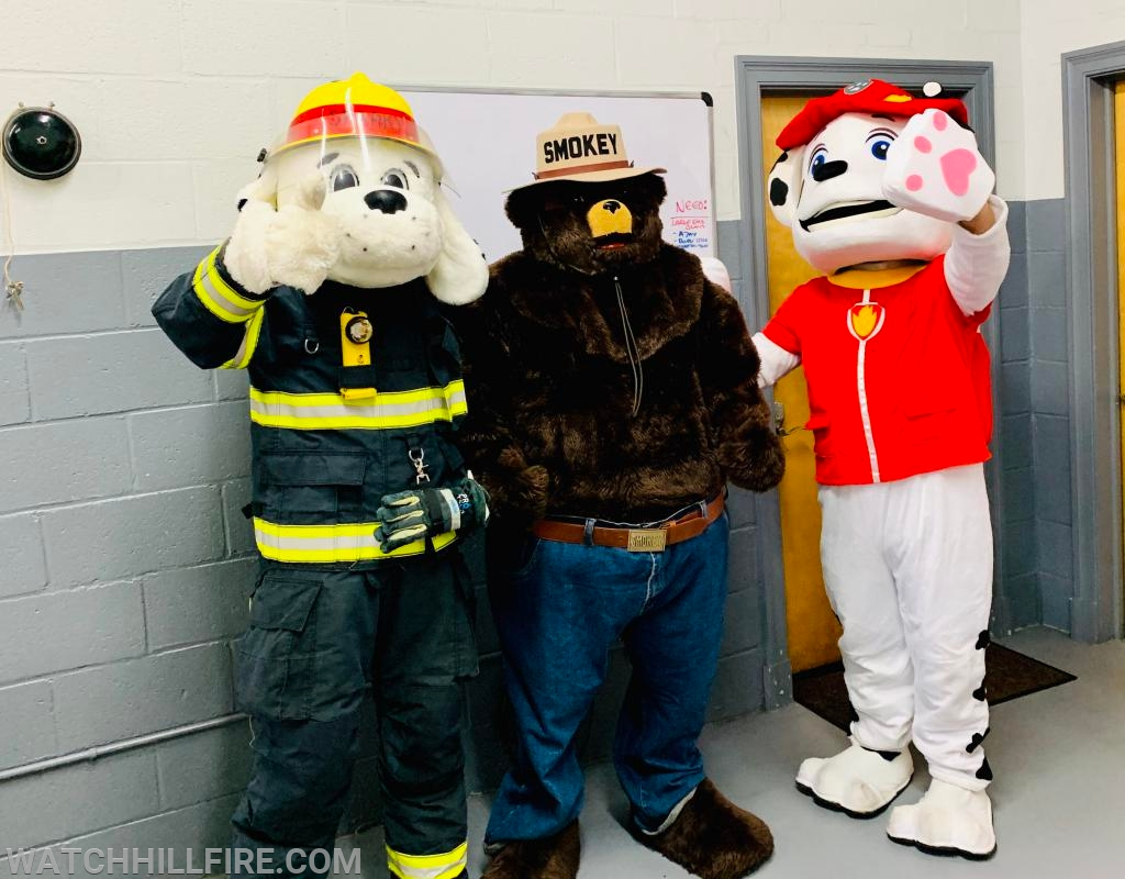 WHFD's friends all pose for a quick picture in the bays as they go about their assignments during Open House