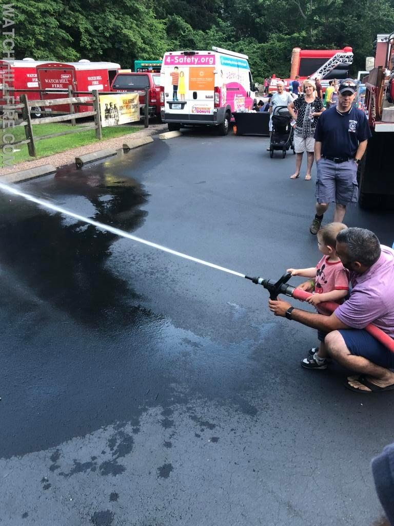 Westerly FD Captain Sam Homsi enjoys some time on the line with his son at Open House