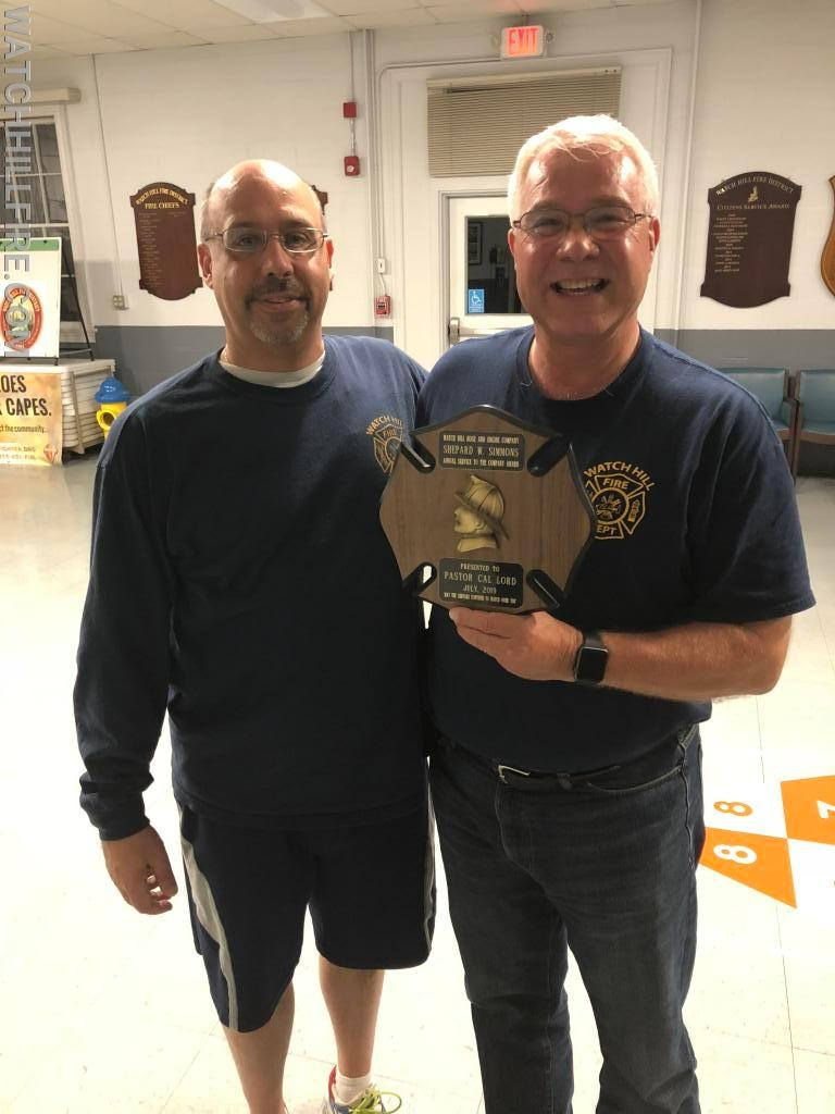 Deputy Chief Jason Simmons presents WHFD Chaplain Rev. Cal Lord with the 2019 Shep Simmons Award during our monthly meeting.