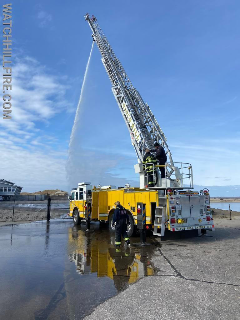 Watch Hill Ladder 104 is a 100 foot aluminum aerial ladder with a 2000 gallon per minute pump, a 500 gallon tank, 128 feet of ground ladders, and 1000 feet of large diameter supply hose. Commonly this type of fire apparatus is referred to as a Quint.