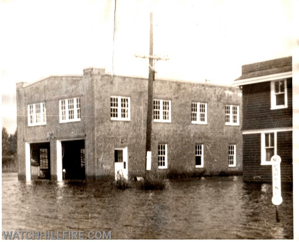 The hydrant was located inside the building between the two garage doors and is visible in this photo which was taken following the Hurricane of 1954. This flooding event ultimately led the taxpayers to approve a new station to be built in 1956 on much higher ground approximately one mile from the harbor.
