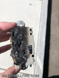 This outlet malfunctioned and began to smoke after a slight burning smell had been noticed earlier in the day.  The rear view shows obvious signs of extensive melting and charring.