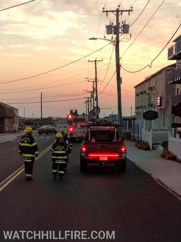 Watch Hill Captain Perkins and Watch Hill Firefighter Wood check in with Misquamicut Firefighter Turnberg at the scene of an early morning mutual aid response with Watch Hill Ladder 104 to a three story hotel on Atlantic Avenue in Misquamicut.