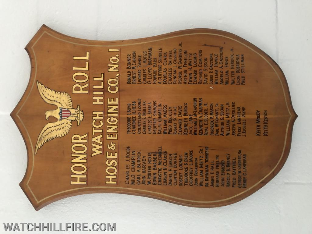This wooden plaque lists the names of all current and former Watch Hill Firefighters who served our country during a time of war.