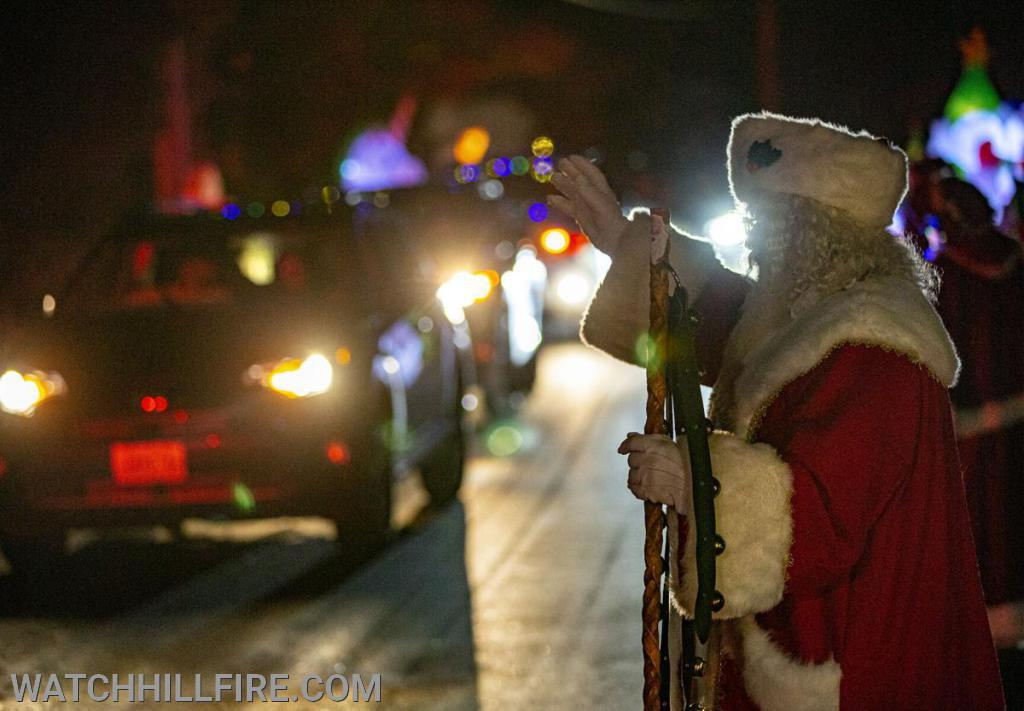 Santa Waves to the passing cars.  Photo from the Westerly Sun
