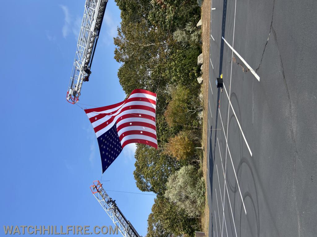 Firefighters from Westerly and Watch Hill practiced setting up and displaying the new flag when it arrived.