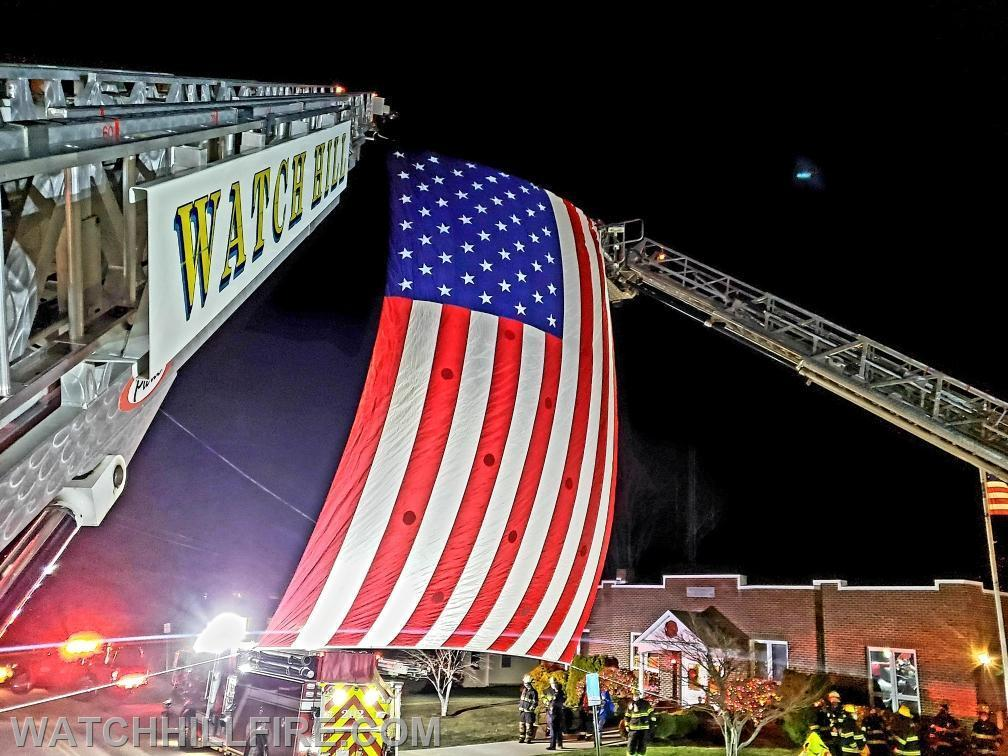 The flag was displayed during a drive by event to honor Philip Panciera for his more than 60 years of dedicated service to the Misquamicut Fire Department.