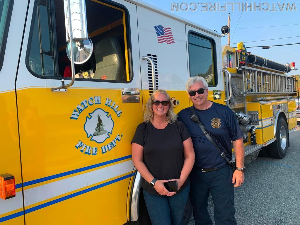 Lieutenant Mello and his sister Kathy with Engine 103