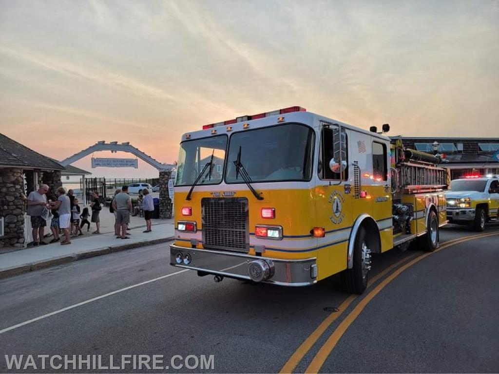 Engine 103 and Squad 100 at the last stop of the parade on Bay Street in Watch Hill
