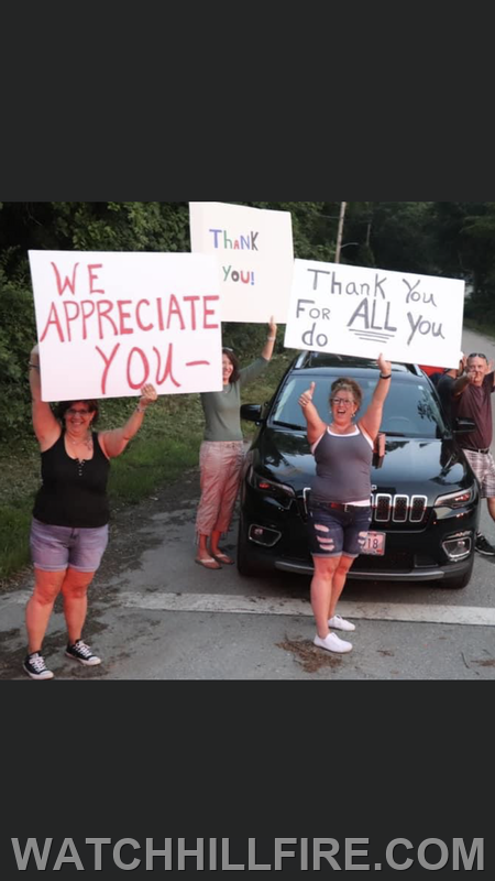 Some of our many longtime supporters wave and display signs of appreciation as the parade passes Oakwood Road in Watch Hill Photo compliments of Dunn's Corners Fire