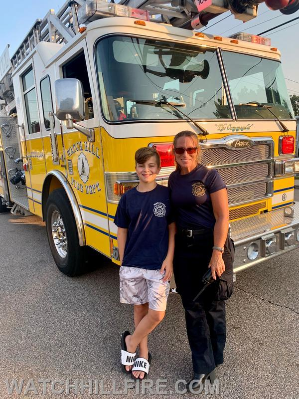 Captain Perkins and her son Christian with Ladder 104