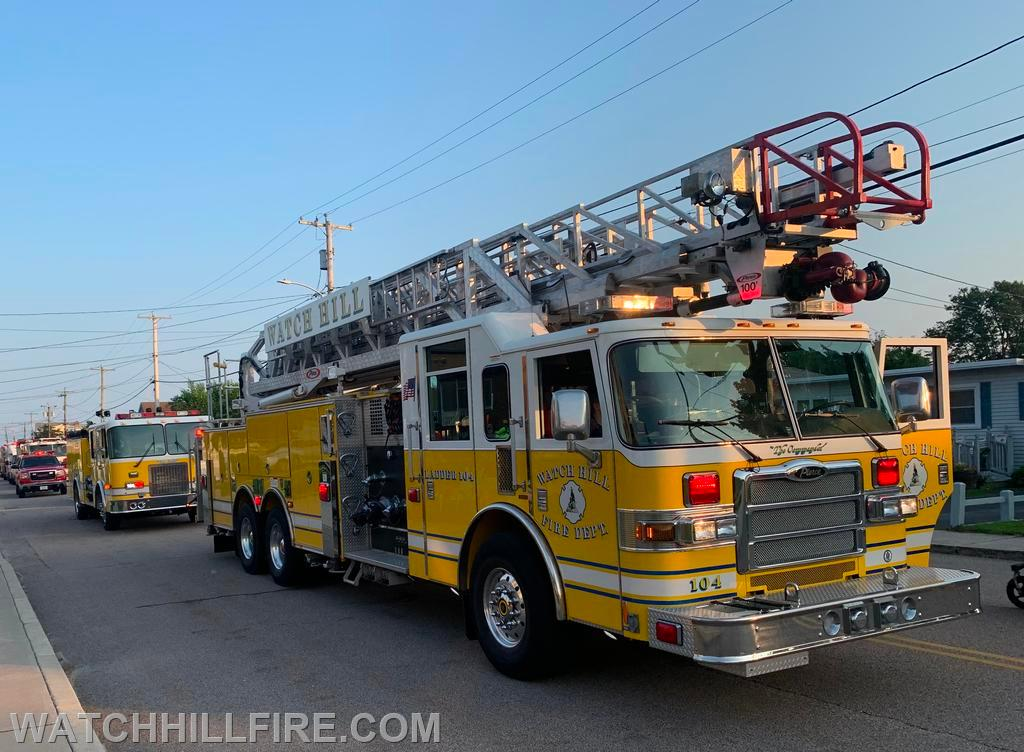 Ladder 104, Engine 103, and Truck 100  at the second stop of the parade in Weekapaug