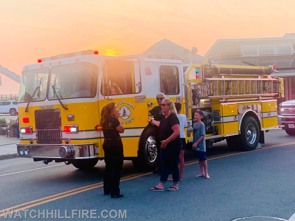 Children and adults check out Engine 103 at the last stop of the parade on Bay Street in Watch Hill