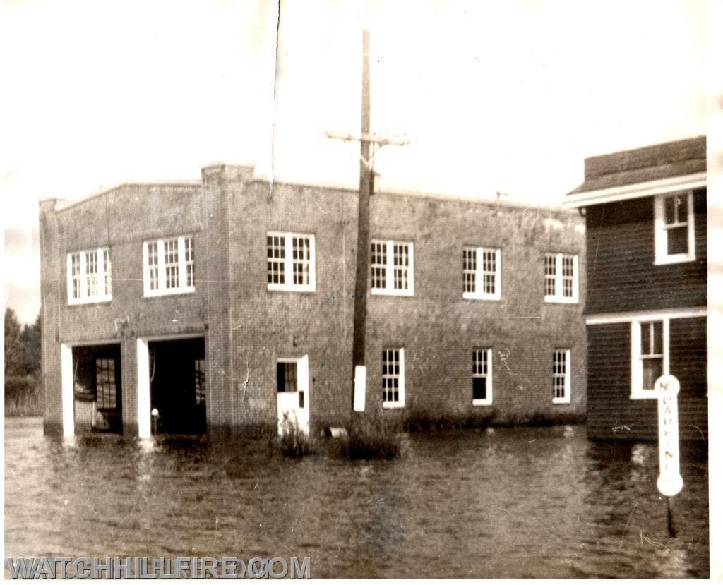 The hydrant was located just inside the building between the two garage doors and is visible in this photo on the left side of the garage to the right. This photo was taken the day after the Hurricane of 1954 caused significant damage and storm surge. This flooding event ultimately led the taxpayers to approve a new station to be built in 1956 on much higher ground approximately one mile from the harbor.