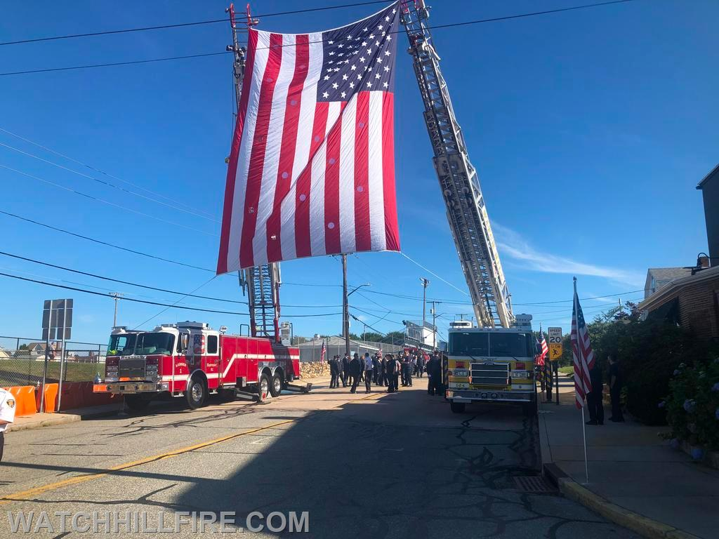 Watch Hill Ladder 104 and Westerly Ladder 1 Display the American Flag at the Beginning of the Procession