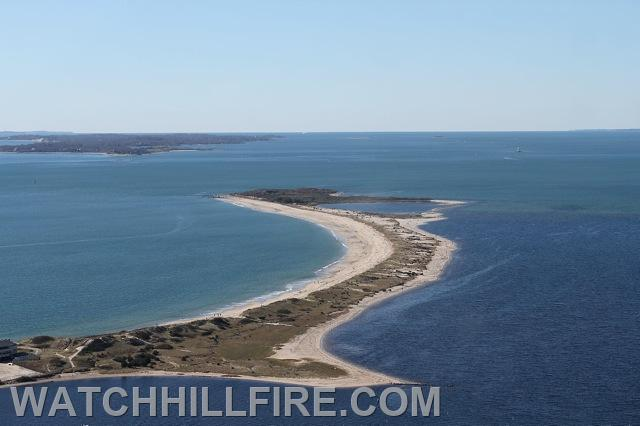 An aerial view of the entire Napatree Point Conservation Area in Watch Hill Rhode Island with Fishers Island New York in the background.