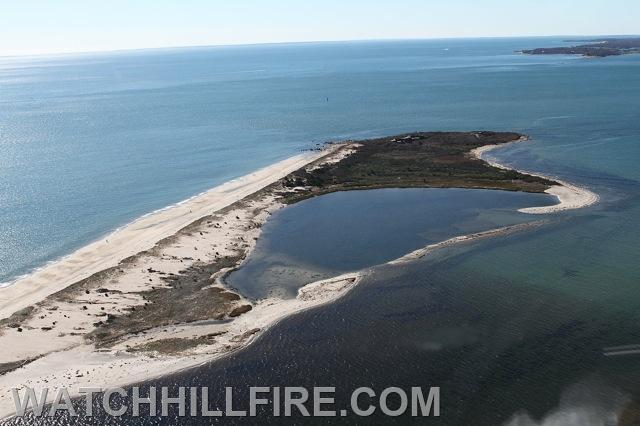 An aerial view of the tip of the Napatree Point Conservation Area in Watch Hill Rhode Island with Fishers Island New York in the background.