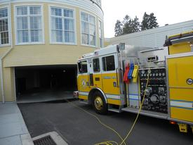 Engine 102 is positioned at the parking garage entrance to the Ocean House.